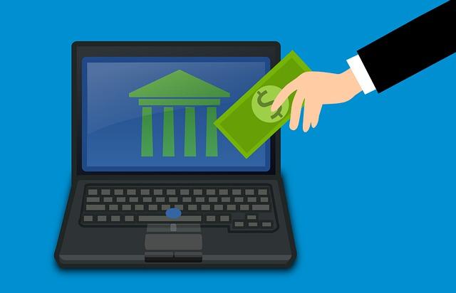 animovaný obrázek NTB a ruky držící dolar – internetové bankovnictví